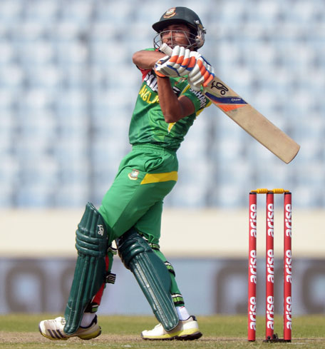 Anamul Haque hits a boundary during the Asia Cup match between Bangladesh and Pakistan in Mirpur on Tuesday March 4. (AFP)