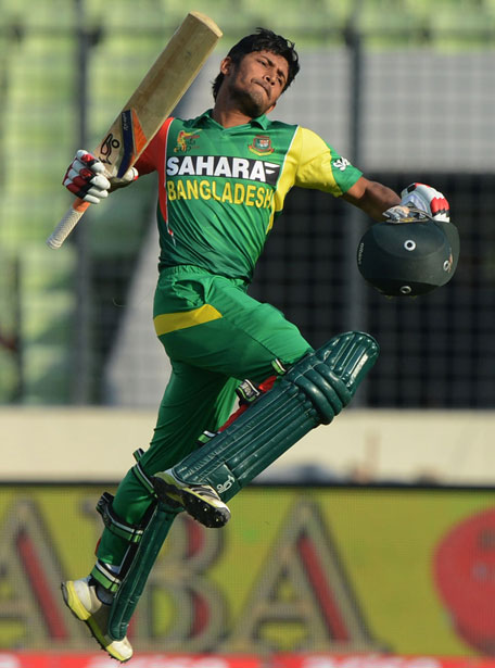 Anamul Haque jumps in delight after scoring a century during the Asia Cup match between Bangladesh and Pakistan in Mirpur on Tuesday March 4. (AFP)