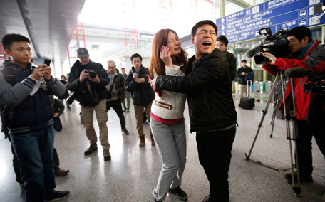A woman (C), believed to be the relative of a passenger onboard Malaysia Airlines flight MH370, cries as she talks on her mobile phone at the Beijing Capital International Airport in Beijing, March 8, 2014. The Malaysia Airlines Boeing B777-200 aircraft carrying 227 passengers and 12 crew lost contact with air traffic controllers early on Saturday en route from Kuala Lumpur to Beijing, the airline said in a statement. (REUTERS)