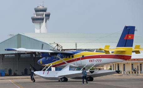 A sea plane taxis as it prepares to take off for a search flight to the southern seas off the coast of Vietnam, from a military airport in Ho Chi Minh City on March 9, 2014. Malaysia on March 9 launched a terror probe into the disappearance of a Malaysian Airlines passenger jet carrying 239 people the day before, investigating suspect passengers who boarded with stolen passports, as relatives begged for news of their loved ones. The United States sent the FBI to investigate after Malaysia Airlines flight MH370 vanished from radar early on March 8 somewhere at sea between Malaysia and Vietnam, but stressed there was no evidence of terrorism yet.       (AFP)