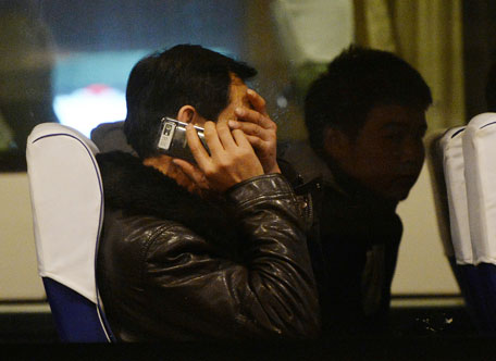 Relatives of passengers from the missing Malaysia Airlines Boeing 777-200 plane wait inside a bus at the Lido Hotel in Beijing on March 10, 2014.   The desperate search for a Malaysian jet which vanished carrying 239 people was significantly expanded on Monday with frustrations mounting over the failure to find any trace of the plane. The initial zone spread over a 50 nautical miles (92 kilometres) radius around the point where flight MH370 disappeared over the South China Sea in the early hours of Saturday morning, en route from Kuala Lumpur to Beijing. Malaysian authorities announced it was doubling the size of the search area to 100 nautical miles. (AFP)