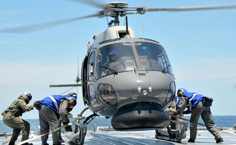 In this photo released by The Royal Malaysian Navy, a Royal Malaysian Navy Fennec helicopter prepares to depart to aid in the search and rescue efforts for the missing Malaysia Airlines plane over the Straits of Malacca, Malaysia, Thursday, March 13, 2014. Planes sent Thursday to check the spot where Chinese satellite images showed possible debris from the missing Malaysian jetliner found nothing, Malaysia's civil aviation chief said, deflating the latest lead in the six-day hunt. The hunt for the missing Malaysia Airlines flight 370 has been punctuated by false leads since it disappeared with 239 people aboard about an hour after leaving Kuala Lumpur for Beijing early Saturday. (AP)