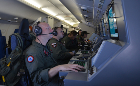 Crew members on board a U.S. Navy P-8A Poseidon man their workstations while assisting in search operations for Malaysia Airlines flight MH370 over the Indian Ocean, in this handout photo taken March 16, 2014. Malaysia has appealed for help and international coordination in a search for its missing passenger jet that stretches across two corridors from the Caspian Sea to the southern Indian Ocean, diplomats said on Sunday. (REUTERS)