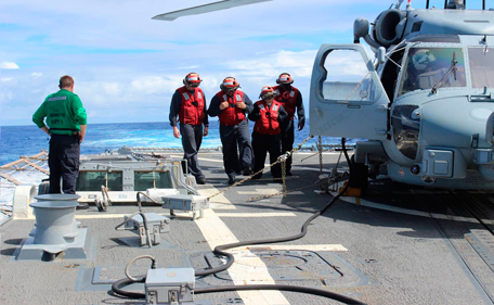 Sailors inspect the flight deck of the Arleigh Burke-class destroyer USS Kidd in this U.S. Navy handout picture taken March 16, 2014. The Kidd will end its search for the missing Malaysian Airlines flight MH370 in a few days, according to the U.S. Defense Department.  (REUTERS)