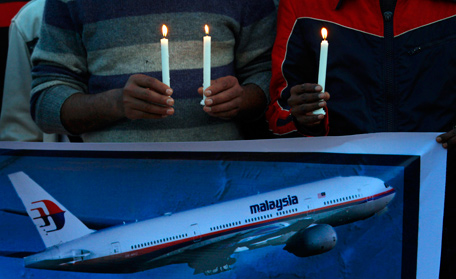 Members of the social group Christian Muslim Alliance Pakistan take part in a candlelight vigil for passengers that were aboard a missing Malaysia Airlines plane, Tuesday, March 18, 2014 in Islamabad, Pakistan. The search for Malaysian Flight 370, which vanished early March 8, 2014 while flying from Kuala Lumpur to Beijing with 239 people on board, has now been expanded deep into the northern and southern hemispheres. (AP)