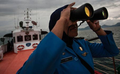 A personnel of Indonesia's National Search and Rescue looks over horizon during a search in the Andaman sea area around northern tip of Indonesia's Sumatra island for the missing Malaysian Airlines flight MH370. (AFP)