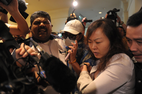 """Chinese relatives of passengers from the missing Malaysia Airlines flight MH370 are stopped and escorted away by Malaysian police from entering the media centre before the start of a press conference at a hotel near Kuala Lumpur International Airport (KLIA) in Sepang, outside Kuala Lumpur on March 19, 2014. Background checks on nearly all but three of the 239 passengers and crew on board a missing Malaysia Airlines jet have produced no """"information of significance"""", Transport Minister Hishammuddin Hussein said on March 19. (AFP)"""