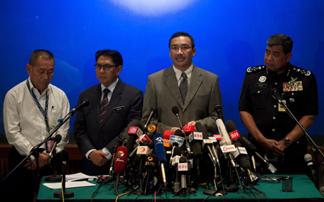"""Malaysia's Minister of Defence and Acting Transport Minister Hishammuddin Hussein (2nd R) speaks during a press conference at a hotel near Kuala Lumpur International Airport (KLIA) in Sepang on March 19, 2014.Background checks on nearly all but three of the 239 passengers and crew on board a missing Malaysia Airlines jet have produced no """"information of significance"""", Transport Minister Hishammuddin Hussein said on March 19. (AFP)"""
