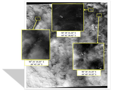 This handout picture received from the Malaysian Remote Sensing Agency (MRSA) on March 27, 2012 shows imagery taken on March 23 by a French satellite showing more than 100 floating objects (within higlighted boxes) in the remote southern Indian Ocean, sparking fresh hopes of a breakthrough in the search for missing Malaysia Airlines jet Flight 370 that vanished on March 8 with 239 passengers and crew on board. Thunderstorms and gale-force winds threatened to impede a frantic international search on March 27 for wreckage from Flight MH370 after satellite images of more than 100 floating objects sparked fresh hopes of a breakthrough. (AFP)