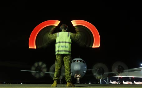 A ground crew directs a  Royal Australian Air Force AP-3C Orion upon its returns to RAAF base Pearce from searching for the missing Malaysian Airlines flight MH370 over the southern Indian Oceanat in Bullsbrook. (AFP)