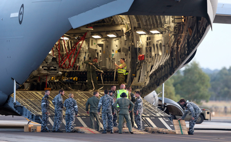 Ground crew prepare to unload a Sea Hawk helicopter from a Royal Australia Air Force C-17 after it landed at RAAF Base Pearce to help with the search for the missing Malaysia Airlines Flight MH370 in Perth, Australia, Friday, March 28, 2014. Australian officials moved the search area for the lost Malaysian jetliner 1,100 kilometers (680 miles) to the northeast Friday, following a new analysis of radar data, and a plane quickly found objects that a ship set out to investigate. (AP)