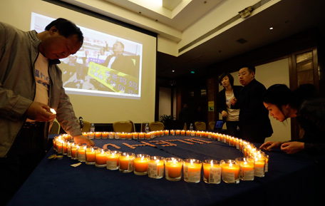 Relatives of passengers onboard Malaysia Airlines Flight MH370 light candles for a prayer ahead of a briefing to be given by Malaysian representatives at Lido Hotel in Beijing March 29, 2014. Chinese ships trawled a new area in the Indian Ocean for the missing Malaysian passenger jet on Saturday, as the search for Flight MH370 entered its fourth week amid a series of false dawns over sightings of debris. (REUTERS)