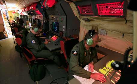 Members of the Royal Australian Air Force (RAAF) No. 292 Squadron man their stations aboard an RAAF AP-3C Orion maratime patrol aircraft as they continue searching in the southern Indian Ocean for the missing Malaysian Airlines flight MH370 in this picture released by the Australian Defence Force April 3, 2014. Australian officials warned bad weather and a lack of reliable information were impeding efforts to find wreckage from the plane. (REUTERS)