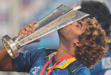 Lasith Malinga of Sri Lanka kisses the trophy after winning the Final of the ICC World Twenty20 Bangladesh 2014 between India and Sri Lanka at Sher-e-Bangla Mirpur Stadium on April 4, 2014 in Dhaka, Bangladesh. (GETTY)