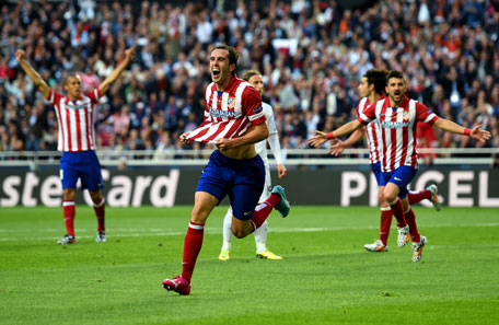 Diego Godin of Club Atletico de Madrid celebrates scoring the opening goal during the UEFA Champions League Final between Real Madrid and Atletico de Madrid at Estadio da Luz on May 24, 2014 in Lisbon, Portugal. (GETTY)