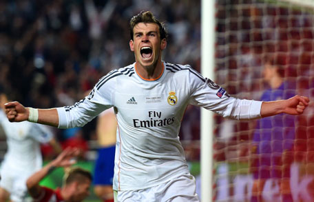 Gareth Bale of Real Madrid celebrates scoring their second goal in extra time during the UEFA Champions League Final between Real Madrid and Atletico de Madrid at Estadio da Luz on May 24, 2014 in Lisbon, Portugal. (GETTY)