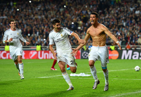 Cristiano Ronaldo of Real Madrid celebrates after scoring their fourth goal from the penalty spot during the UEFA Champions League Final between Real Madrid and Atletico de Madrid at Estadio da Luz on May 24, 2014 in Lisbon, Portugal. (GETTY)