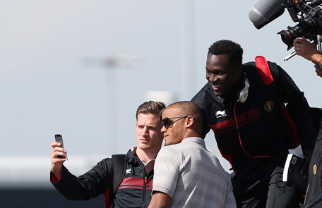 Belgium's national soccer team players Jan Vertonghen, Vincent Kompany and Romelu Lukaku pose for a photograph before boarding a plane bound for 2014 World Cup in Brazil at Brussels international airport June 10, 2014. (REUTERS)