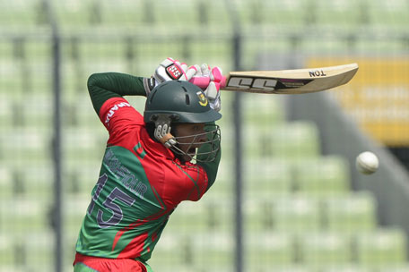 Bangladeshi cricket captain Mushfiqur Rahim plays a shot during the One Day International cricket match between India and Bangladesh at the Sher-e-Bangla National Cricket Stadium in Dhaka on June 15, 2014. (AFP)