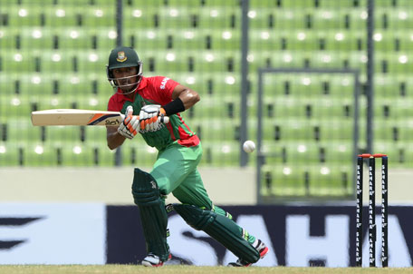 Bangladeshi cricketer Anamul Haque plays a shot during the One Day International between India and Bangladesh at the Sher-e-Bangla National Cricket Stadium in Dhaka on June 15, 2014. (AFP)