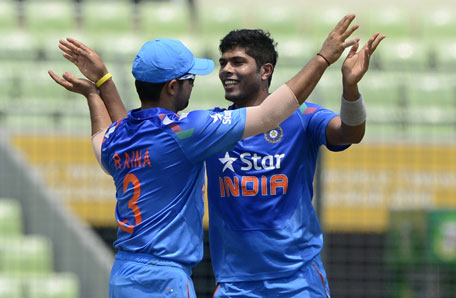 Indian bowler Umesh Yadav (right) celebrates with team captain Suresh Raina after the dismissal of Bangladeshi cricketer Tamim Iqbal during the One Day International between India and Bangladesh at the Sher-e-Bangla National Cricket Stadium in Dhaka on June 15, 2014. (AFP)
