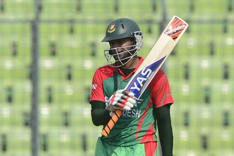 Bangladeshi cricketer Shakib Al Hasan reacts after scoring a half-century during the One Day International between India and Bangladesh at the Sher-e-Bangla National Cricket Stadium in Dhaka on June 15, 2014. (AFP)