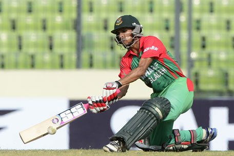 Bangladeshi cricketer Nasir Hossain plays a shot during the One Day International between India and Bangladesh at the Sher-e-Bangla National Cricket Stadium in Dhaka on June 15, 2014. (AFP)