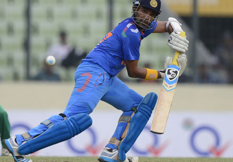 Indian cricketer Robin Uthappa plays a shot during the one day international between India and Bangladesh at the Sher-e-Bangla National Cricket Stadium in Dhaka on June 15, 2014. (AFP)