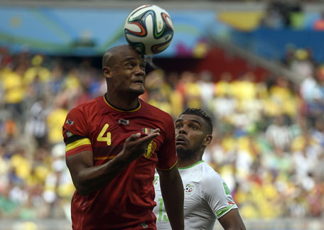 Algeria's forward El Arabi Soudani (right) and Belgium's defender Vincent Kompany vie for the ball during a Group H football match at the Mineirao Stadium in Belo Horizonte during the 2014 FIFA World Cup on June 17, 2014. (AFP)