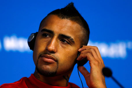 Chile's Arturo Vidal listens to a question during a news conference at the Corinthians arena in Sao Paulo city, June 22, 2014. (REUTERS)
