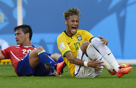 Brazil's forward Neymar (right) reacts after being fouled by Chile's midfielder Charles Aranguiz during the round of 16 football match between Brazil and Chile at The Mineirao Stadium in Belo Horizonte during the 2014 FIFA World Cup on June 28, 2014. (AFP)