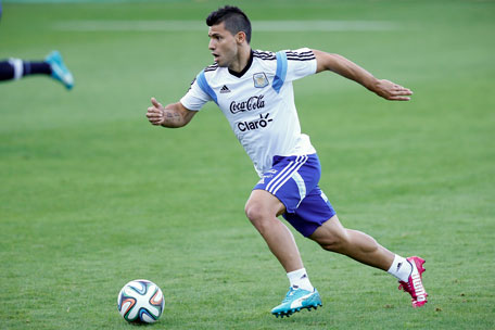 Argentina's Sergio Aguero runs with the ball during a training session in Vespesiano, near Belo Horizonte, Brazil, Sunday, July 6, 2014. (AP)