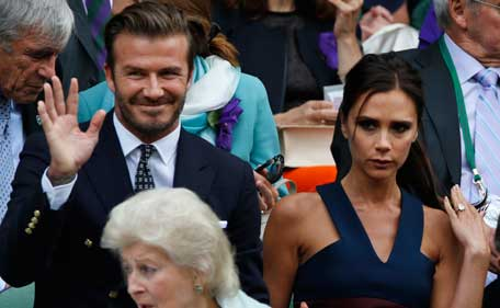 David and Victoria Beckham take their seats in the Royal Box prior to the men's singles final between Roger Federer of Switzerland and Novak Djokovic of Serbia on centre court at the All England Lawn Tennis Championships in Wimbledon, London, Sunday July 6, 2014. (AP)