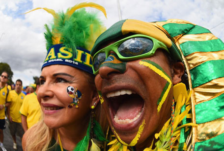 Brazil fans enjoy the atmosphere prior to kickoff during the 2014 FIFA World Cup Brazil Semi Final match between Brazil and Germany at Estadio Mineirao on July 8, 2014 in Belo Horizonte, Brazil. (GETTY)