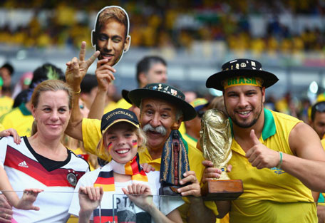 Fans enjoy the atmosphere prior to kickoff during the 2014 FIFA World Cup Brazil Semi Final match between Brazil and Germany at Estadio Mineirao on July 8, 2014 in Belo Horizonte, Brazil. (GETTY)