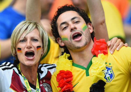 Germany and Brazil fans enjoy the atmosphere prior to the 2014 FIFA World Cup Brazil Semi Final match between Brazil and Germany at Estadio Mineirao on July 8, 2014 in Belo Horizonte, Brazil. (GETTY)