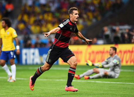 Miroslav Klose of Germany celebrates scoring his team's second goal during the 2014 FIFA World Cup Brazil Semi Final match between Brazil and Germany at Estadio Mineirao on July 8, 2014 in Belo Horizonte, Brazil. (GETTY)