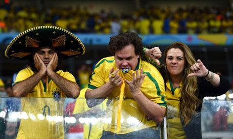Emotional Brazil fans react after being defeated by Germany 7-1 during the 2014 FIFA World Cup Brazil Semi Final match between Brazil and Germany at Estadio Mineirao on July 8, 2014 in Belo Horizonte, Brazil. (GETTY)