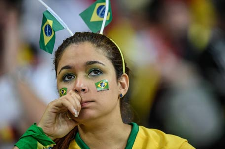A fan of Brazil gestures during the Brazil 2014 FIFA World Cup. (AFP)