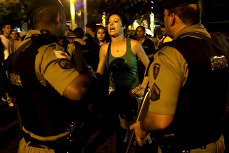 A female Brazilian supporter shouts insults at the police after fights broke out while watching her team lose to Germany on a live telecast of the semi-final World Cup soccer match, in Belo Horizonte, Brazil. (AFP)