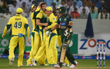 Australian cricket players celebrate after dismissing Pakistani batsman Shahid Afridi (right) during the first International T20 cricket match in Dubai on October 5, 2012. (AFP)