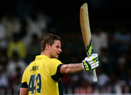 Australian bowler Steven Smith reacts after reaching a century during Australia's first One Day International cricket match against Pakistan in Sharjah on October 7, 2014. (AFP)