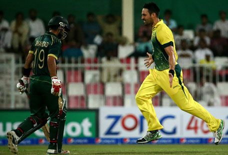 Australian bowler Mitchel Johnson (right) jubilates after dismissing Pakistani batsman Ahmed Shehzad during their first One Day International cricket match in Sharjah on October 7, 2014. (AFP)