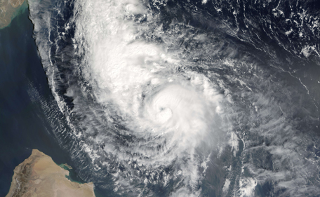 """This October 27, 2014 NASA satellite photo shows Tropical Cyclone Nilofar in the Arabian Sea. Indian officials were preparing Monday to evacuate residents and stockpile food as they braced for another """"very severe cyclonic storm"""" due to slam into the country's west coast and neighbouring Pakistan. Cyclone Nilofar, building in the Arabian Sea, is due to hit India's Gujarat state and Pakistan's southern coastal areas on Friday morning, the Indian Meterological Department said. The storm, packing winds of up to 125 kilometres (83 miles) per hour, comes after Cyclone HudHud hit India's east coast earlier this month leaving some 20 people dead. (AFP)"""