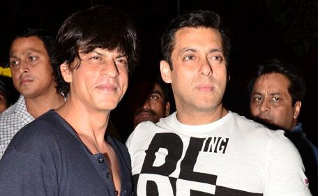 Bollywood actors Shah Rukh Khan (L) and Salman Khan pose for photographers. (Sanskriti Media and Entertainment)