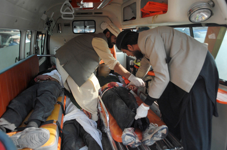 Men move bodies of students, who were killed during an attack by Taliban gunmen on the Army Public School, in an ambulance outside a hospital in Peshawar, December 16, 2014. Taliban gunmen in Pakistan took hundreds of students and teachers hostage on Tuesday in a school in the northwestern city of Peshawar, military officials said.  REUTERS