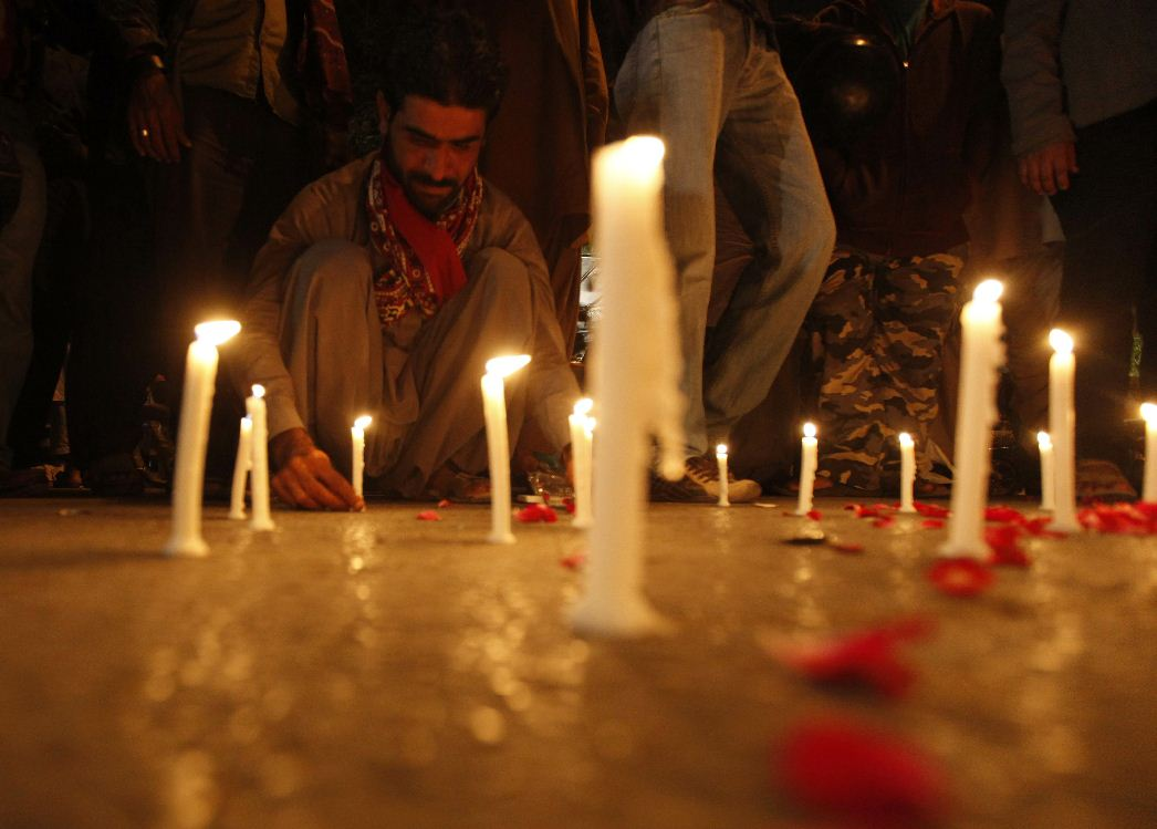 A man lights candles to mourn the victims from the Army Public School in Peshawar, which was attacked by Taliban gunmen, in Karachi, December 16, 2014. Taliban gunmen in Pakistan took hundreds of students and teachers hostage on Tuesday in a school in the northwestern city of Peshawar, military officials said. (Reuters)