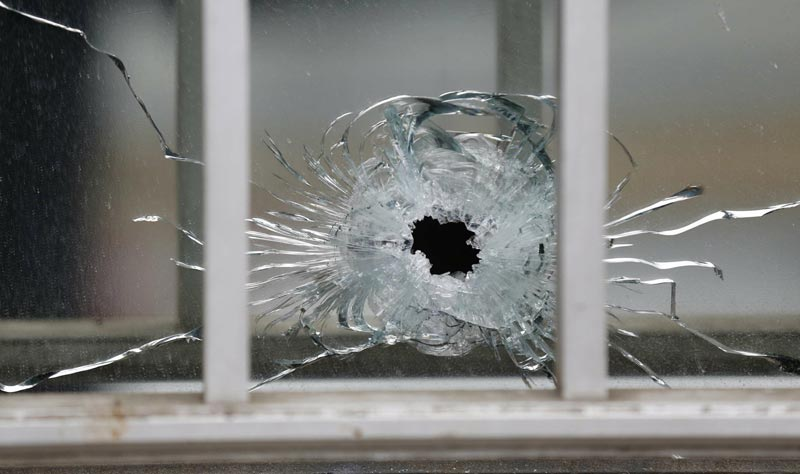 A bullet's impact is seen on a window at the scene after a shooting at the Paris offices of Charlie Hebdo, a satirical newspaper, January 7, 2015.  (Reuters)