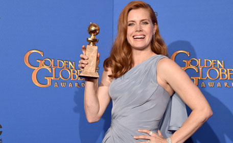 Actress Amy Adams, winner of Best Actress in a Motion Picture ? Musical or Comedy for 'Big Eyes,' poses in the press room during the 72nd Annual Golden Globe Awards at The Beverly Hilton Hotel on January 11, 2015 in Beverly Hills, California. (AFP)