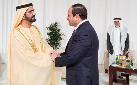 Sheikh Mohammed bin Rashid and Egyptian President Abdul Fattah El Sisi at a reception before the opening of the Zayed Future Energy Summit in Abu Dhabi on Monday. (Wam)